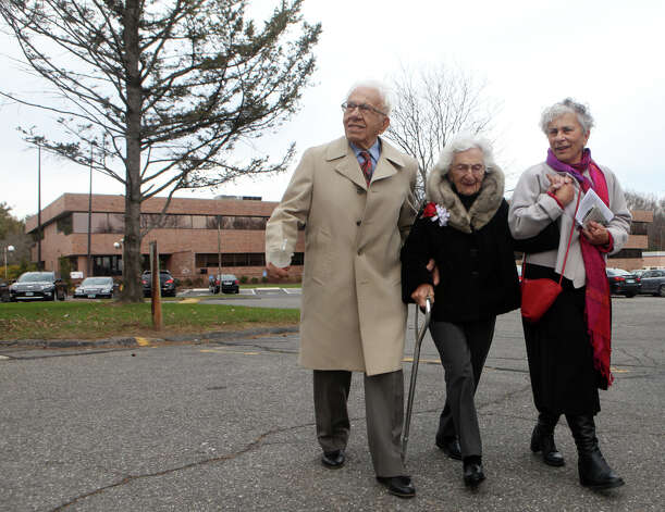 John and Ann Betar, of Fairfield, celebrate their 80th anniversary at St. Nicholas Antiochian Orthodox Church, in Bridgeport, Conn. on Sunday, November 25, 2012. Walking with the Betars is their youngest daughter Renee Betar. Photo: BK Angeletti, B.K. Angeletti / Connecticut Post freelance B.K. Angeletti