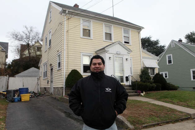 Rudy Polanco stands in front of his Wood Ave.  home after he and his family escaped a morning fire in Bridgeport, Conn. on Monday morning, November 25, 2012. Photo: BK Angeletti, B.K. Angeletti / Connecticut Post freelance B.K. Angeletti