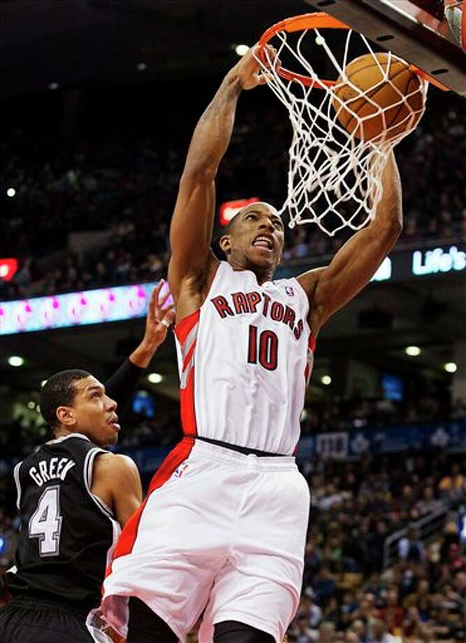 Toronto Raptors' DeMar DeRozan (10) dunks against San Antonio Spurs' Danny Green (4) during the first half of an NBA basketball game, Sunday, Nov. 25, 2012, in Toronto. (AP Photo/The Canadian Press, Aaron Vincent Elkaim) Photo: Aaron Vincent Elkaim, Associated Press / The Canadian Press
