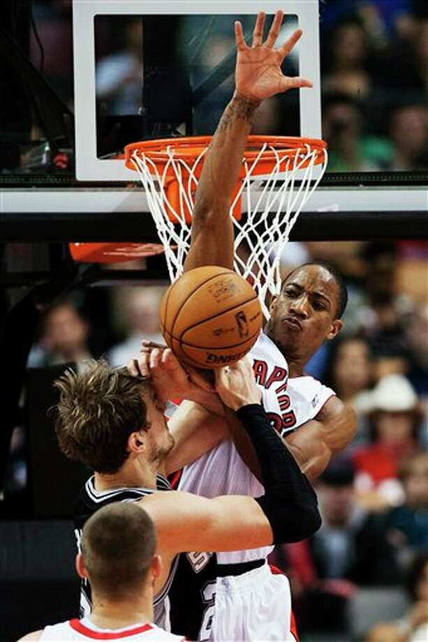 Toronto Raptors' DeMar DeRozan, right, fouls San Antonio Spurs' Tiago Splitter during the first half of an NBA basketball game, Sunday, Nov. 25, 2012, in Toronto. (AP Photo/The Canadian Press, Aaron Vincent Elkaim) Photo: Aaron Vincent Elkaim, Associated Press / The Canadian Press