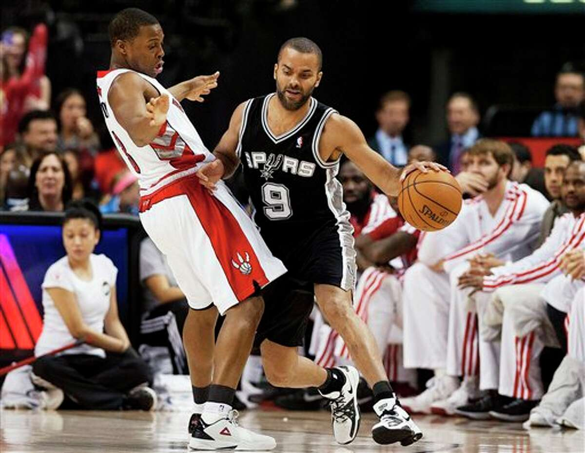 Toronto Raptors' Kyle Lowry, left, defends San Antonio Spurs' Tony Parker (9) during the first half of an NBA basketball game, Sunday, Nov. 25, 2012, in Toronto. (AP Photo/The Canadian Press, Aaron Vincent Elkaim)