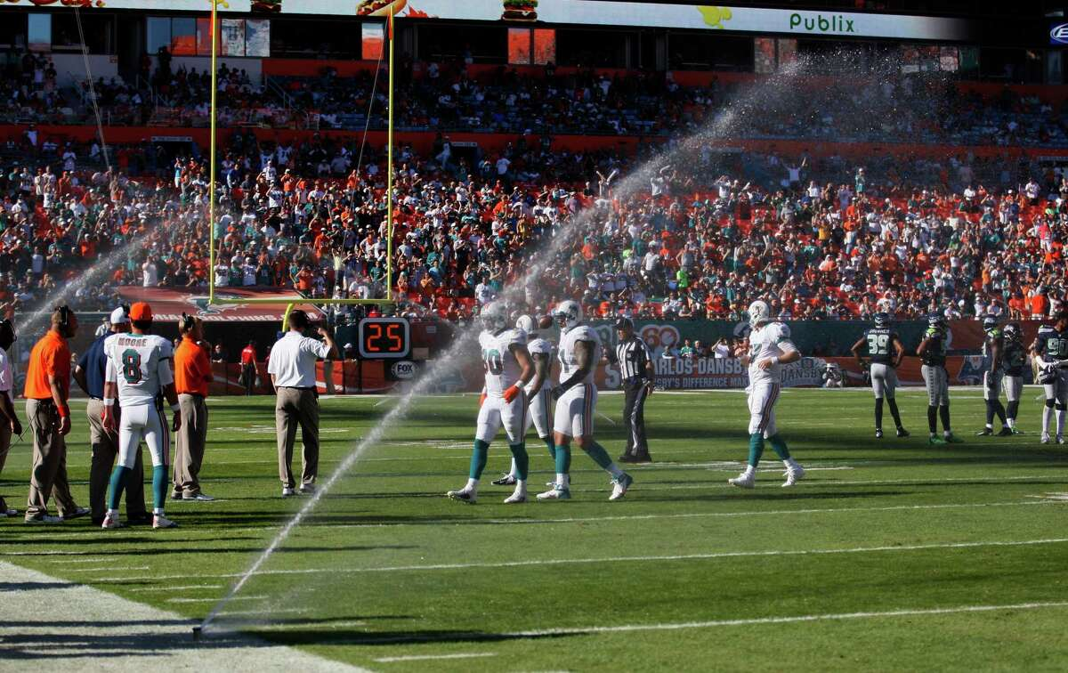 Sprinklers come on during the second half of an NFL football game between the Miami Dolphins and Seattle Seahawks, Sunday, Nov. 25, 2012 in Miami.
