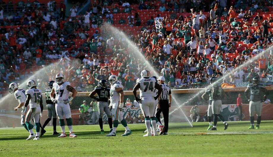 Sprinklers go on during the second half of an NFL football game between the Miami Dolphins and Seattle Seahawks, Sunday, Nov. 25, 2012 in Miami. Photo: AP