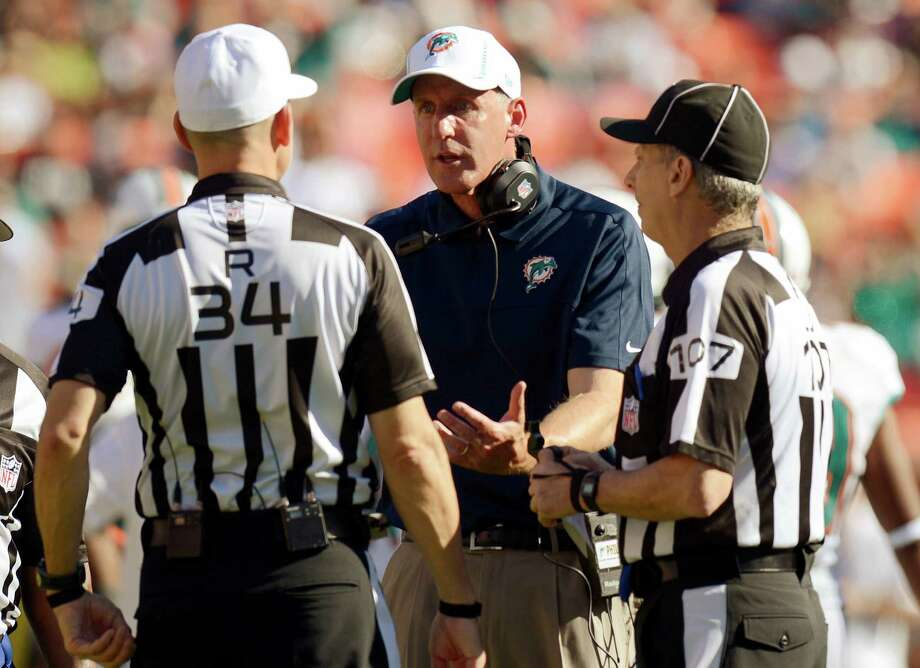 Miami Dolphins head coach Joe Philbin, second from right, argues a call with officials during the first half of an NFL football game against the Seattle Seahawks, Sunday, Nov. 25, 2012, in Miami. Photo: AP