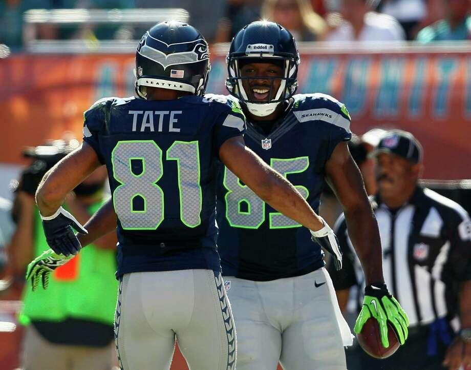Seattle Seahawks tight end Anthony McCoy (85) is congratulated by Golden Tate after Mc Coy scored a touchdown against the Miami Dolphins during the first half of an NFL football game Sunday, Nov. 25, 2012 in Miami. Photo: AP