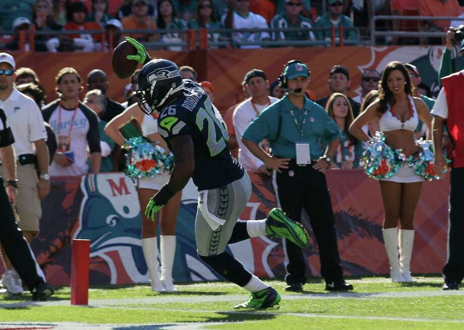 Seattle Seahawks fullback Michael Robinson (26) scores a touchdown during the second half of an NFL football game against the Miami Dolphins, Sunday, Nov. 25, 2012 in Miami. Photo: AP