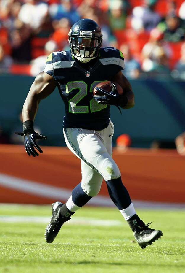 Seattle Seahawks running back Robert Turbin (22) runs with the ball during the second half of an NFL football game against the Miami Dolphins, Sunday, Nov. 25, 2012 in Miami. Photo: AP