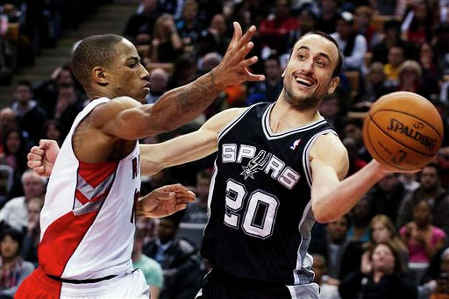 San Antonio Spurs' Manu Ginobili (20) passes the ball around Toronto Raptors' DeMar DeRozan during the second half of an NBA basketball game, Sunday, Nov. 25, 2012, in Toronto. The Spurs won 111-106. (AP Photo/The Canadian Press, Aaron Vincent Elkaim) Photo: Aaron Vincent Elkaim, Associated Press / The Canadian Press
