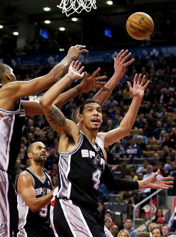 San Antonio Spurs' Danny Green is misses a layup under pressure from the Toronto Raptors during the second half of an NBA basketball game, Sunday, Nov. 25, 2012, in Toronto. The Spurs won 111-106. (AP Photo/The Canadian Press, Aaron Vincent Elkaim) Photo: Aaron Vincent Elkaim, Associated Press / The Canadian Press