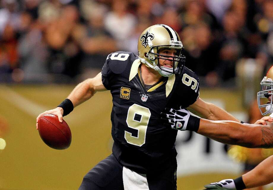 New Orleans Saints quarterback Drew Brees (9) scrambles in the first half of an NFL football game against the San Francisco 49ers at the Louisiana Superdome in New Orleans, Sunday, Nov. 25, 2012. Photo: Gerald Herbert, Associated Press / AP