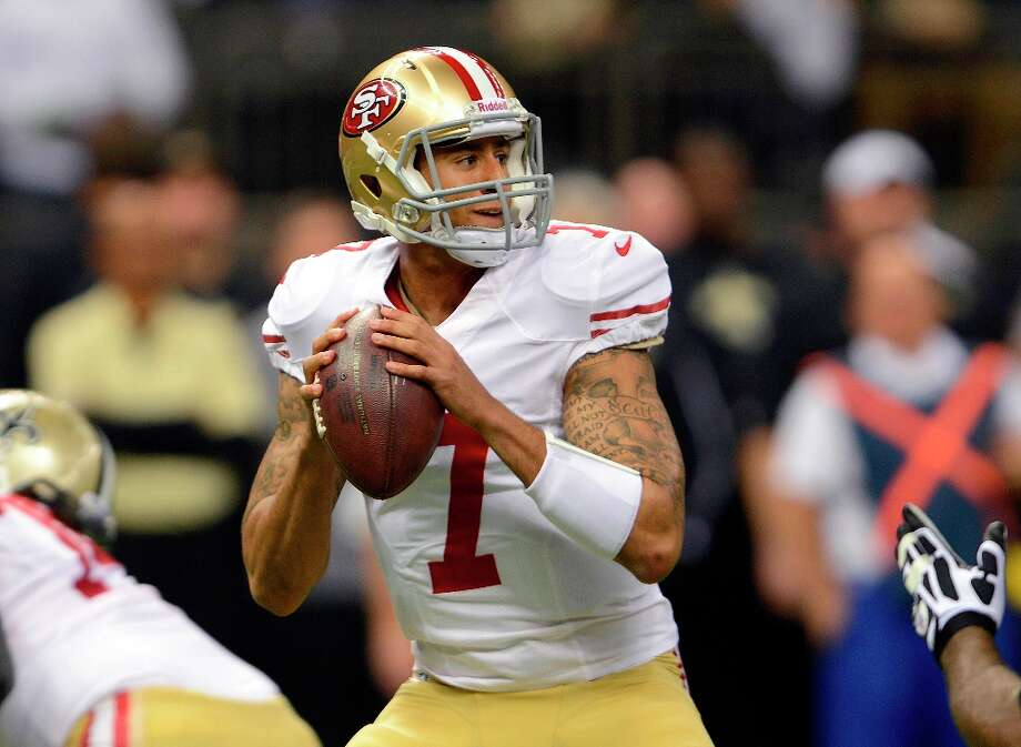 San Francisco 49ers quarterback Colin Kaepernick (7) drops back to pass in the first half of an NFL football game against the New Orleans Saints at the Louisiana Superdome in New Orleans, Sunday, Nov. 25, 2012. Photo: Bill Feig, Associated Press / FR44286 AP