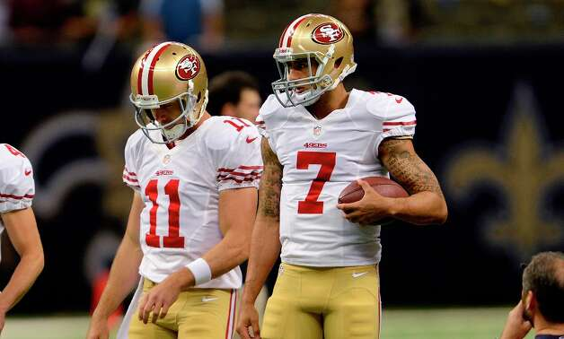 San Francisco 49ers quarterback Alex Smith (11) and quarterback Colin Kaepernick (7) warm up before an NFL football game at the Louisiana Superdome in New Orleans, Sunday, Nov. 25, 2012. Photo: Gerald Herbert, Associated Press / AP