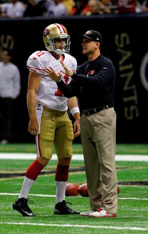 San Francisco 49ers head coach Jim Harbaugh talks with quarterback Alex Smith (11) before an NFL football game against the New Orleans Saints at the Louisiana Superdome in New Orleans, Sunday, Nov. 25, 2012. Photo: Gerald Herbert, Associated Press / AP