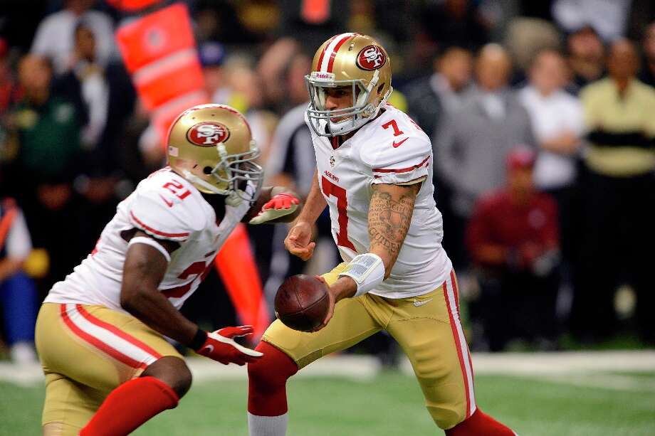 San Francisco 49ers quarterback Colin Kaepernick (7) hands off to running back Frank Gore (21) in the first half of an NFL football game against the New Orleans Saints at the Louisiana Superdome in New Orleans, Sunday, Nov. 25, 2012. Photo: Bill Feig, Associated Press / FR44286 AP