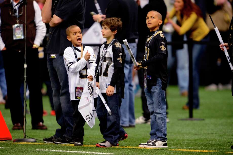 Young New Orleans Saints fans watch warm-ups before an NFL football game against the San Francisco 49ers at the Louisiana Superdome in New Orleans, Sunday, Nov. 25, 2012. Photo: Gerald Herbert, Associated Press / AP
