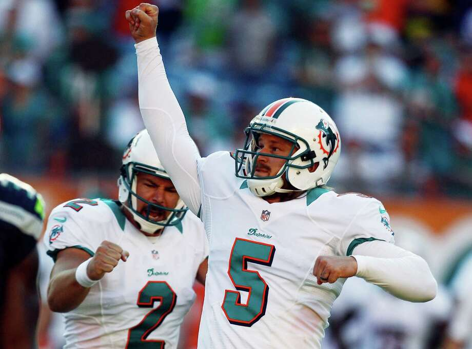 Miami kicker Dan Carpenter (5) and Brandon Fields (2) celebrate Carpenter's game-winning field goal against Seattle during the closing moments of the second half of an NFL football game in Miami on Sunday, Nov. 25, 2012. Miami won 24-21. Photo: AP