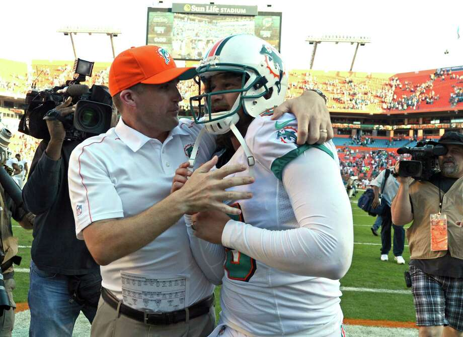 Miami Dolphins kicker Dan Carpenter (5) is lead off the field by special teams coordinator Darren Rizzi after scoring a field goal to win the game during the second half of an NFL football game against the Seattle Seahawks, Sunday, Nov. 25, 2012 in Miami. The Dolphins defeated the Seahawks 24-21. Photo: AP