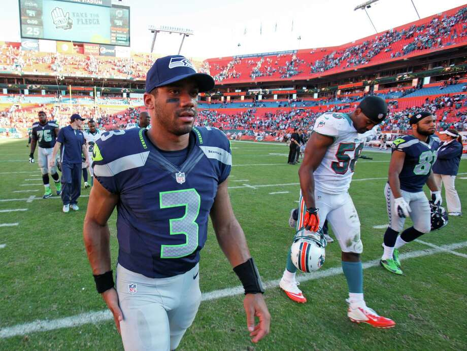 Seattle Seahawks quarterback Russell Wilson (3) walks off the field after the Miami Dolphins beat the Seahawks 24-21 in an NFL football game, Sunday, Nov. 25, 2012 in Miami. Photo: AP