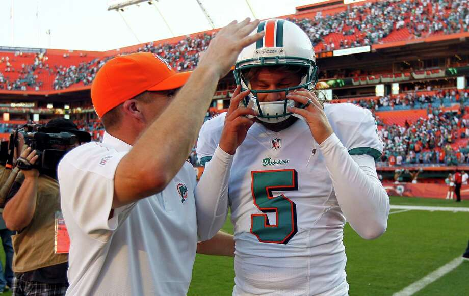 Miami kicker Dan Carpenter (5) is congratulated by special teams coordinator Darren Rizzi following his game winning field goal against Seattle during the closing moments of the second half of an NFL football game in Miami on Sunday, Nov. 25, 2012. Miami won 24-21. Photo: AP