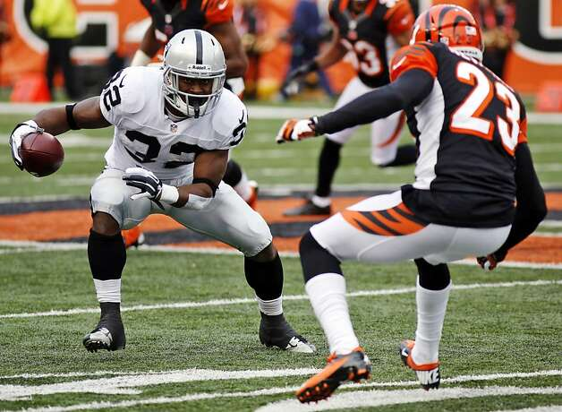 Oakland Raiders fullback Jeremy Stewart (32) runs against Cincinnati Bengals cornerback Terence Newman (23) in the second half of an NFL football game, Sunday, Nov. 25, 2012, in Cincinnati. (AP Photo/David Kohl) Photo: David Kohl, Associated Press