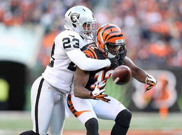 Joselio Hanson (left) forces a fumble by Mohamed Sanu that was returned for a TD, but an inadvertent whistle erased it. Photo: Andy Lyons, Getty Images