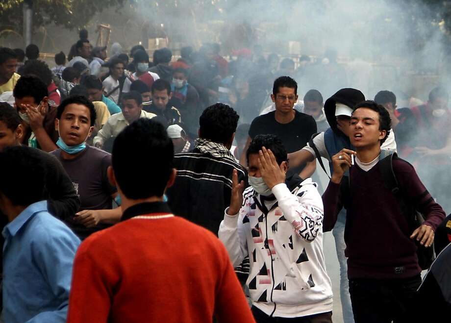 Egyptian protesters clash with security forces, not pictured, near Tahrir Square in Cairo, Egypt, Sunday, Nov. 25, 2012. President Mohammed Morsi edicts, which were announced on Thursday, place him above oversight of any kind, including that of the courts. The move has thrown Egypt's already troubled transition to democracy into further turmoil, sparking angry protests across the country to demand the decrees be immediately rescinded. (AP Photo/Ahmed Gomaa) Photo: Ahmed Gomaa, Associated Press