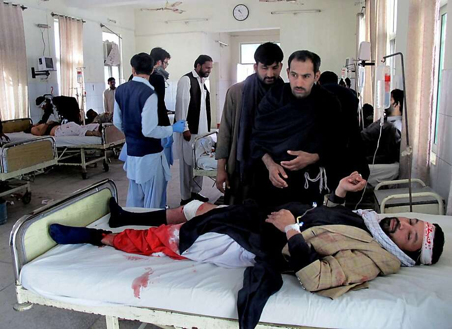 Injured victims of a bomb blast are treated at a local hospital in Dera Ismail Khan, Pakistan, Sunday, Nov. 25, 2012. A bombing claimed by the Taliban killed several people at a Shiite religious process in northwestern Pakistan, police said. (AP Photo/Ishtiaq Mahsud) Photo: Ishtiaq Mahsud, Associated Press