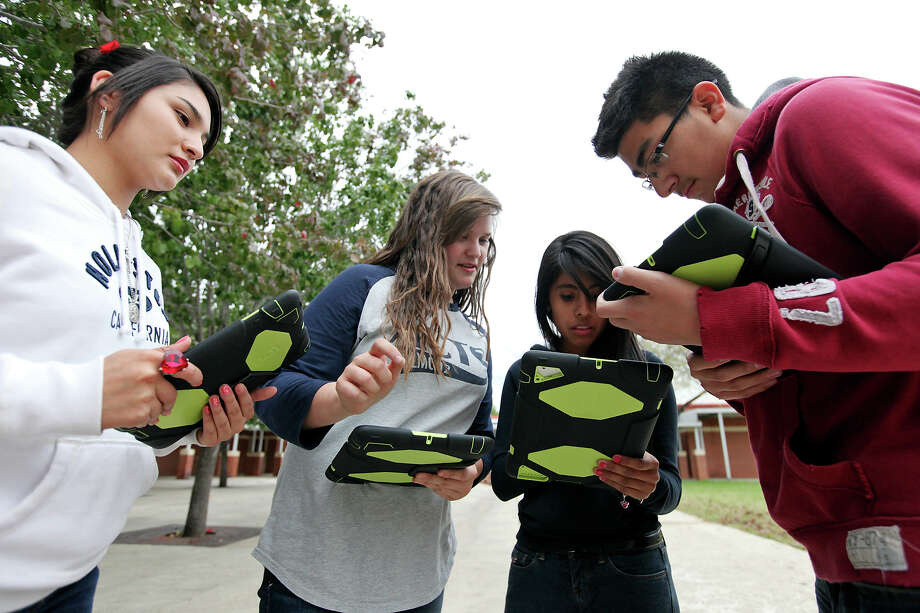 Southside high school freshmen Mallory Mendoza, 14, (from left), Kaitlyn Aldrich, 14, Diana Mendoza, 14, and Joel Ibarra, 14, use iPads Thrusday Nov. 15, 2012 for Leonard Aguilar's Pre-AP english I class at the school. Photo: Edward A. Ornelas, San Antonio Express-News / © 2012 San Antonio Express-News
