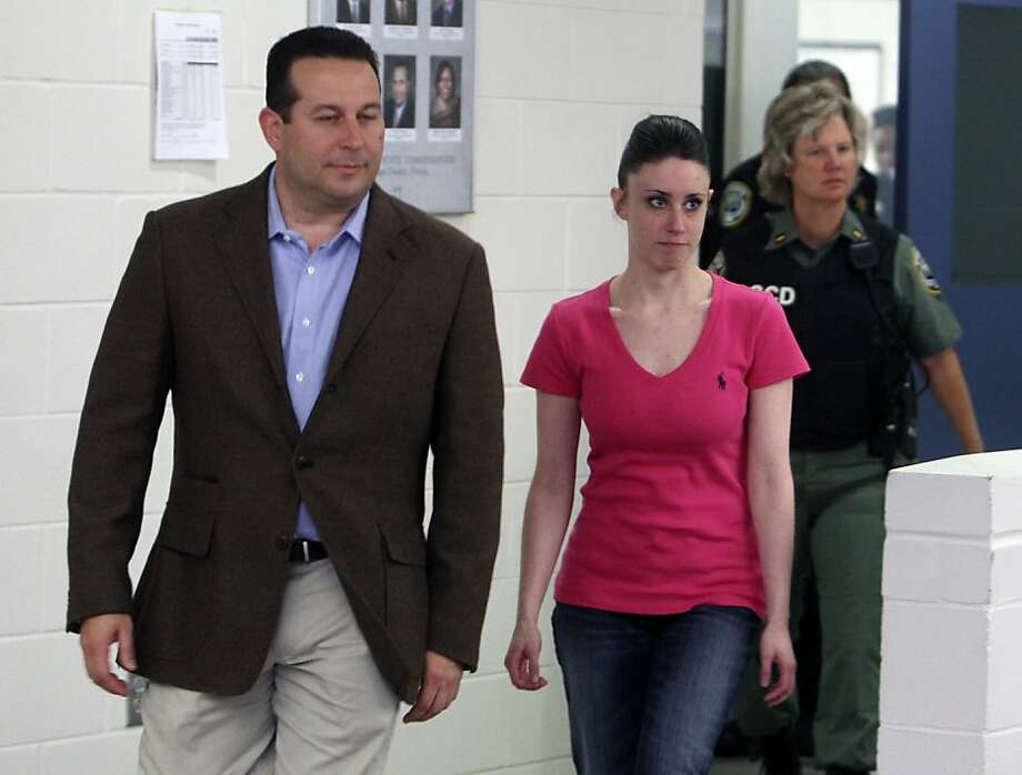 In this Sunday, July 17, 2011 file photo, Casey Anthony, front right, walks out of the Orange County Jail with her attorney Jose Baez, left, during her release in Orlando, Fla., after being acquitted of murder in the death of her daughter Caylee. The Florida sheriff's office that investigated Caylee Anthony's death confirmed Sunday, Nov. 25, 2012, that it overlooked a computer search for suffocation methods made from the little girl's home on the day she was last seen alive. (AP Photo/Red Huber, Pool, File) Photo: Red Huber, Associated Press