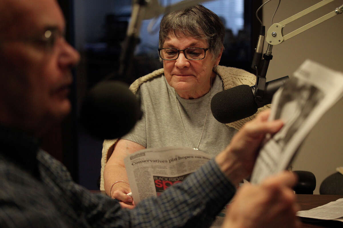 Volunteers George Lewis and Anne Powell take turns reading the San Antonio Express-News to visually impaired listeners at Owl Radio, a service of the Low Vision Resource Center, in San Antonio on Friday, Nov. 23, 2012.