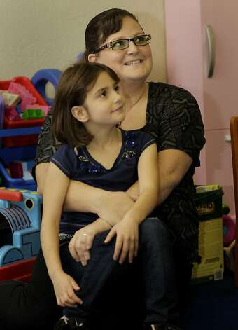 Jennifer Lord and her daughter Kathleen Gangale sat in a play area at the Hamilton Family Center on Hyde Street in San Francisco, Calif. The Benioffs of Salesforce.com have made another contribution to the welfare of homeless families in the Bay Area. Part of the new contribution will go to Hamilton Family Services and continue to help Jennifer Lord, and her daughter Kathleen Gangale. Photo: Brant Ward, The Chronicle