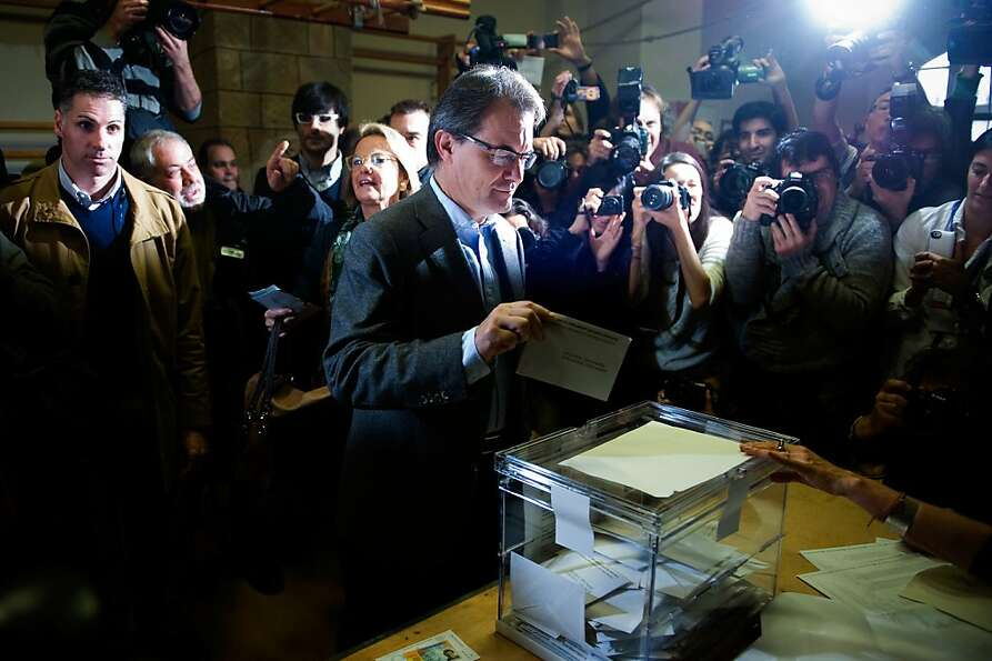 Catalan leader Artur Mas voted in an election that weakened his party in the regional legislature.