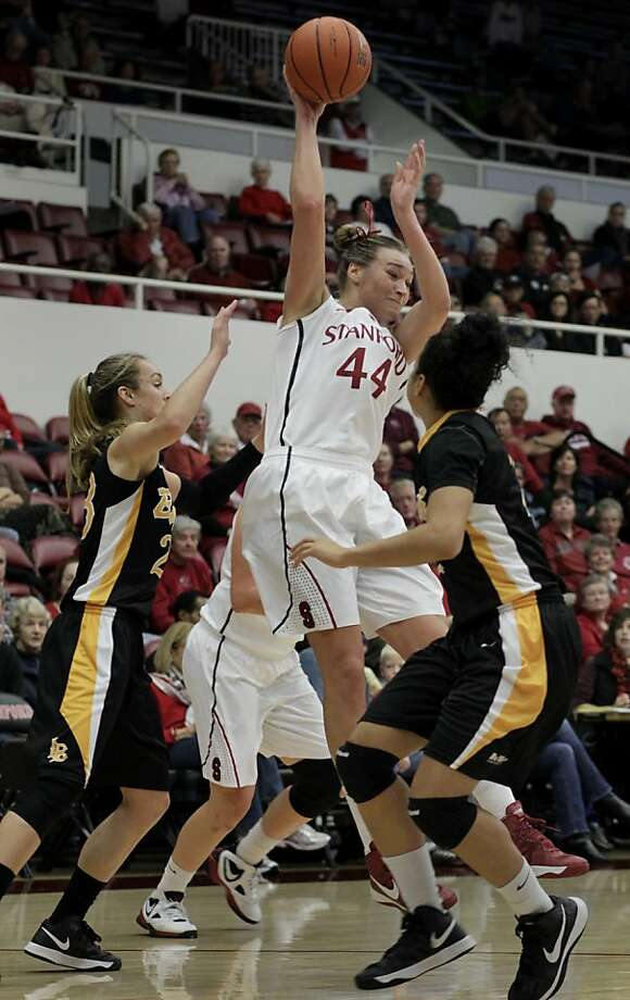Stanford's Joslyn Tinkle made a pass out of trouble past two 49er defenders. The Stanford women's basketball team had an easy victory over Long Beach State Sunday November 25, 2012 at Maples Pavilion. Photo: Brant Ward, The Chronicle