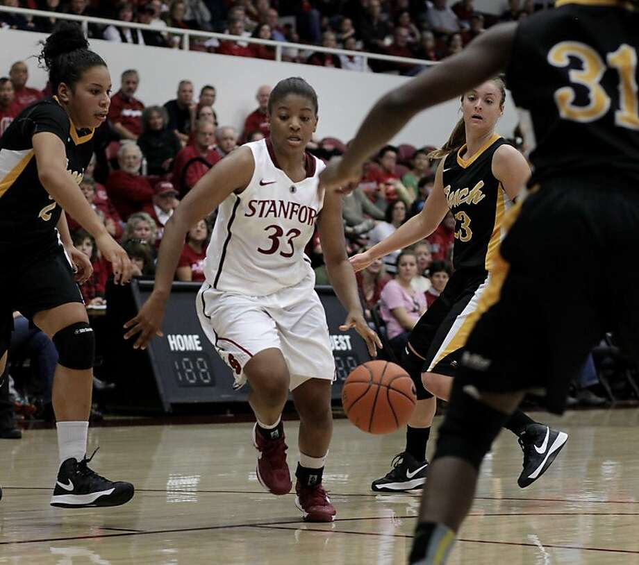 Stanford's Amber Orrange dribbled through traffic in the first half. The Stanford women's basketball team had an easy victory over Long Beach State Sunday November 25, 2012 at Maples Pavilion. Photo: Brant Ward, The Chronicle
