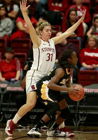 Stanford's Toni Kokenis made life difficult for one 49er. The Stanford women's basketball team had an easy victory over Long Beach State Sunday November 25, 2012 at Maples Pavilion. Photo: Brant Ward, The Chronicle