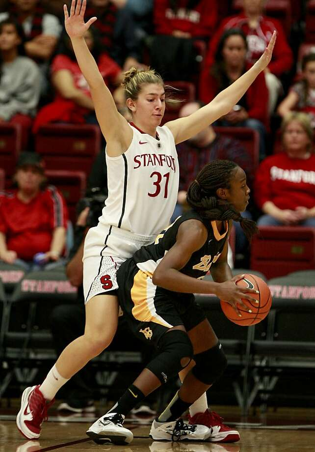 Toni Kokenis (left), an All-Pac-12 guard in the 2011-12 season, was ruled out for this year's Pac-12 Tournament. Photo: Brant Ward, The Chronicle