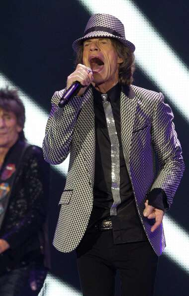 Mick Jagger of The Rolling Stones performs at the O2 arena in east London, Sunday, Nov. 25, 2012. Th