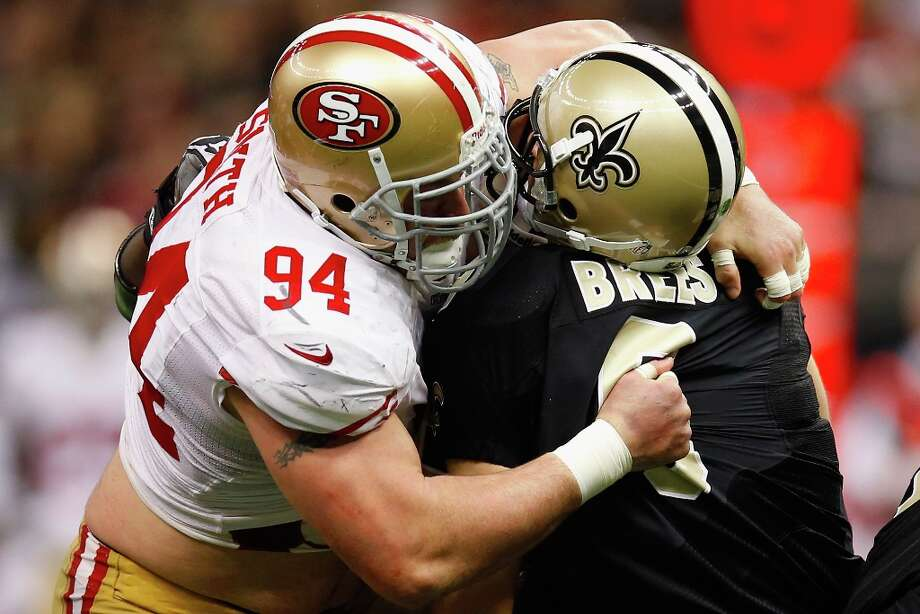 Drew Brees #9 of the New Orleans Saints is sacked by  Justin Smith #94 of the San Francisco 49ers at The Mercedes-Benz Superdome on November 25, 2012 in New Orleans, Louisiana. Photo: Chris Graythen, Getty Images / 2012 Getty Images