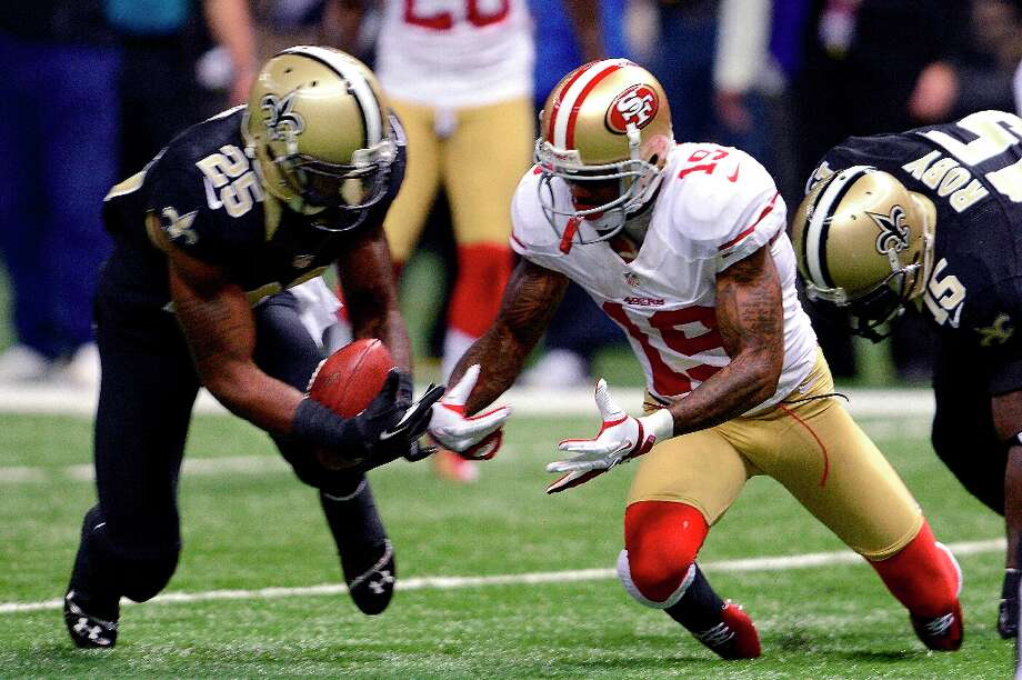 San Francisco 49ers wide receiver Ted Ginn (19) fumbles a punt which is recovered by New Orleans Saints defensive back Rafael Bush (25) in the first half of an NFL football game in New Orleans, Sunday, Nov. 25, 2012. Photo: Bill Feig, Associated Press / FR44286 AP