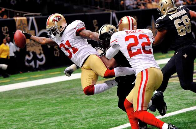 San Francisco 49ers strong safety Donte Whitner (31) scores on a touchdown run in the second half of an NFL football game against the New Orleans Saints in New Orleans, Sunday, Nov. 25, 2012. Photo: Bill Feig, Associated Press / FR44286 AP