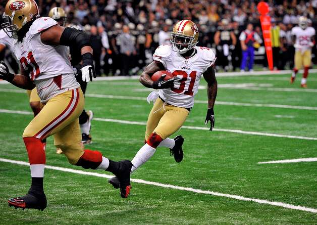 San Francisco 49ers strong safety Donte Whitner (31) scores on a touchdown run in the second half of an NFL football game against the New Orleans Saints at the Louisiana Superdome in New Orleans, Sunday, Nov. 25, 2012. Photo: Bill Feig, Associated Press / FR44286 AP