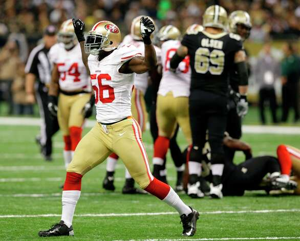 San Francisco 49ers linebacker Tavares Gooden (56) celebrates a tackle in a game between the New Orleans Saints and San Francisco 49ers at the Mercedes-Benz Superdome in New Orleans, La., Sunday, Nov. 25, 2012.  (Matthew Hinton / Special to the Chronicle) Photo: MATTHEW HINTON, SFC / ONLINE_YES