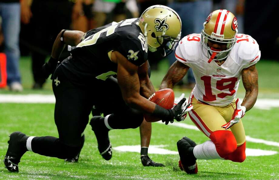 New Orleans Saints defensive back Rafael Bush (25) grabs a fumbled punt by San Francisco 49ers wide receiver Ted Ginn (19) in a game between the New Orleans Saints and San Francisco 49ers at the Mercedes-Benz Superdome in New Orleans, La., Sunday, Nov. 25, 2012.  (Matthew Hinton / Special to the Chronicle) Photo: MATTHEW HINTON, SFC / ONLINE_YES