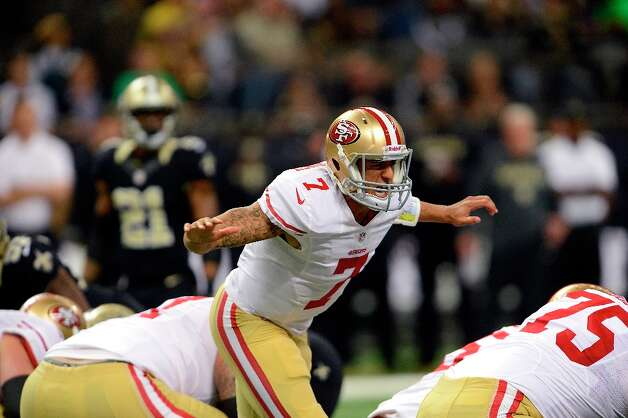 San Francisco 49ers quarterback Colin Kaepernick (7) calls out a play at the line of scrimmage in the first half of an NFL football game against the New Orleans Saints at the Louisiana Superdome in New Orleans, Sunday, Nov. 25, 2012. Photo: Bill Feig, Associated Press / FR44286 AP