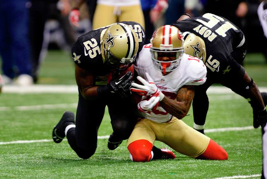 New Orleans Saints defensive back Rafael Bush (25) pulls in a fumble on a punt by San Francisco 49ers wide receiver Ted Ginn (19) in the first half of an NFL football game at the Louisiana Superdome in New Orleans, Sunday, Nov. 25, 2012. Photo: Bill Feig, Associated Press / FR44286 AP