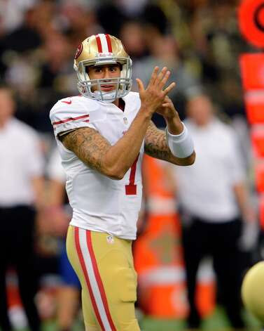 San Francisco 49ers quarterback Colin Kaepernick (7) gestures at the line of scrimmage in the first half of an NFL football game against the New Orleans Saints at the Louisiana Superdome in New Orleans, Sunday, Nov. 25, 2012. Photo: Bill Feig, Associated Press / FR44286 AP