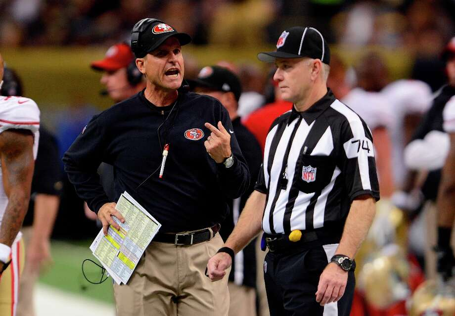 San Francisco 49ers head coach Jim Harbaugh, left, calls to an official in the first half of an NFL football game against the New Orleans Saints in New Orleans, Sunday, Nov. 25, 2012. Photo: Bill Feig, Associated Press / FR44286 AP