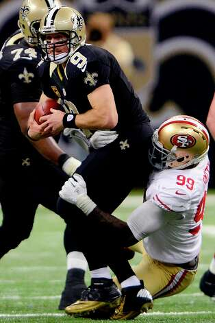 New Orleans Saints quarterback Drew Brees (9) is sacked by San Francisco 49ers outside linebacker Aldon Smith (99) in the second half of an NFL football game in New Orleans, Sunday, Nov. 25, 2012. Photo: Bill Feig, Associated Press / FR44286 AP