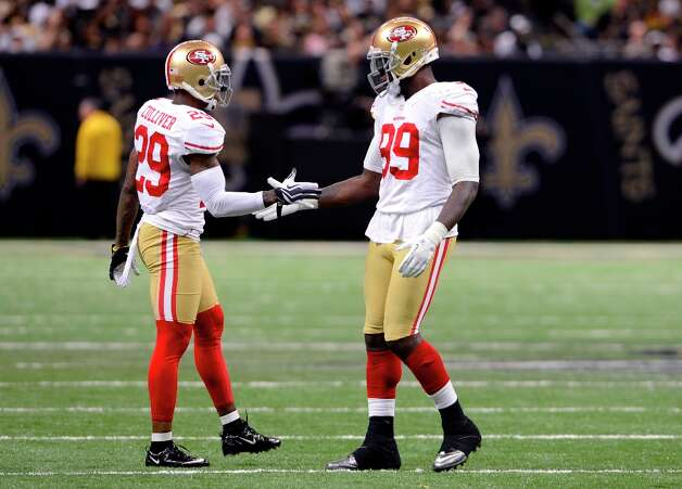 San Francisco 49ers outside linebacker Aldon Smith (99) greets defensive back Chris Culliver (29) in the second half of an NFL football game at the Louisiana Superdome in New Orleans, Sunday, Nov. 25, 2012. Photo: Bill Feig, Associated Press / FR44286 AP