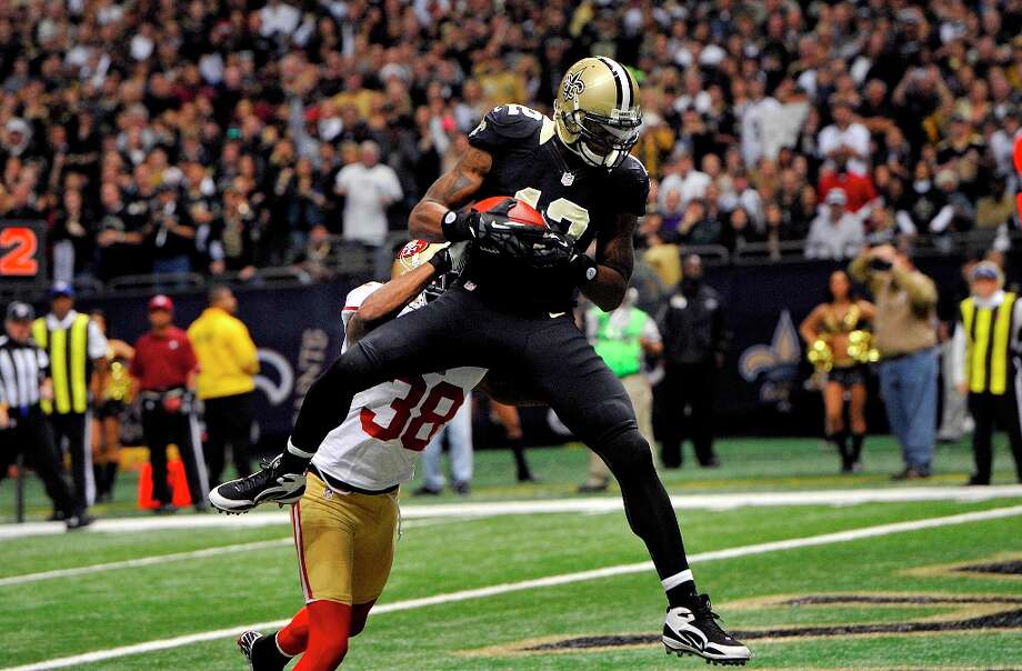 New Orleans Saints wide receiver Marques Colston (12) pulls in a touchdown reception as San Francisco 49ers free safety Dashon Goldson (38) covers  in the first half of an NFL football game at the Louisiana Superdome in New Orleans, Sunday, Nov. 25, 2012. Photo: Bill Feig, Associated Press / FR44286 AP